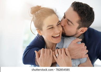 Cheerful romantic couple of lovers cuddling