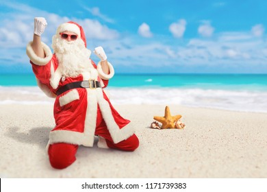 Cheerful Santa Claus is happy  about his perfect sunny vacation destination at the beach.