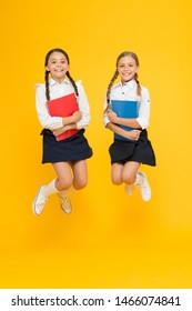 Cheerful school girls. Back to school. Point out positive aspects starting school create positive anticipation first day class. Bring child school few days prior play playground and get comfortable.