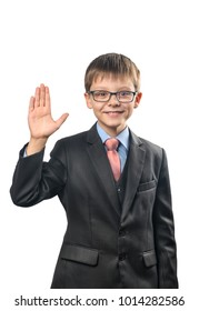 Cheerful schoolboy with glasses waving his hand on a white background