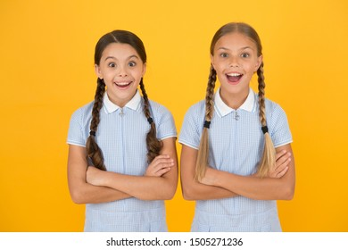 Cheerful schoolgirls yellow background. Little girls. Happy childrens day. Equal protection civil rights and freedom from discrimination. Perfect schoolgirls. Schoolgirls vintage simple style outfit.