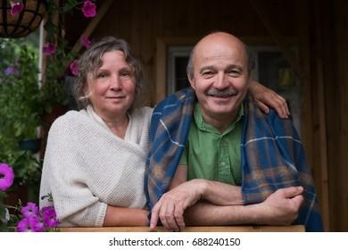 Cheerful senior couple enjoying life at countryside house
