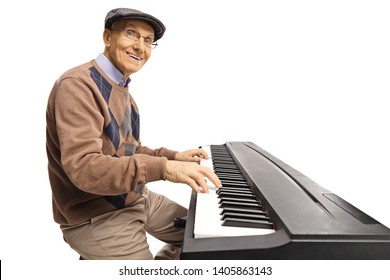 Cheerful senior man playing a digital keyboard piano isolated on white background