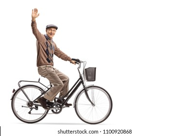 Cheerful senior riding a bicycle and waving at the camera isolated on white background