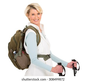 cheerful senior woman with backpack and hiking poles