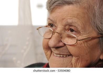 Cheerful senior woman laughing
