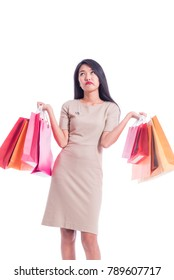Cheerful shopping woman of Asian holding bags. Shopping smart business woman unhappy Bored and tired holding colorful shopping bags isolated on white . Fresh young Asian female model
