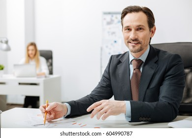 Cheerful smiling businessman working in the office