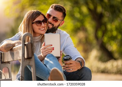 Cheerful smiling couple in love hugging outdoors.People,love,happiness,travel and lifestyle concept.