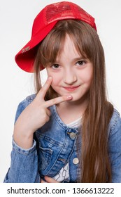 Cheerful smiling girl, looking at the camera, funny gestured