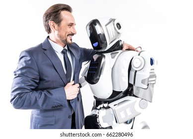 Cheerful smiling man embracing cyborg
