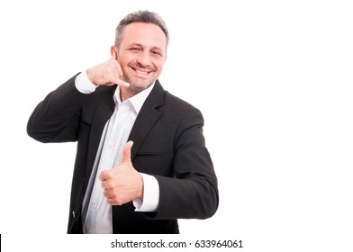 Cheerful smiling man making call me gesture with hand and showing thumb up isolated on white with advertising area