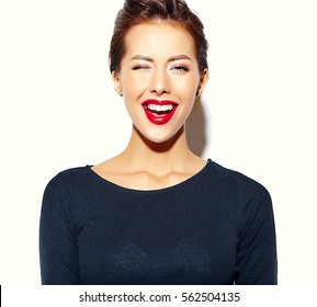 cheerful smiling winking fashion girl going crazy in casual black clothes with red lips on white background