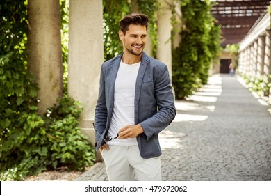 Cheerful smiling young male model in white shirt