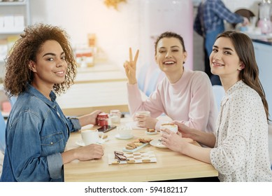 Cheerful smiling young woman in cafe