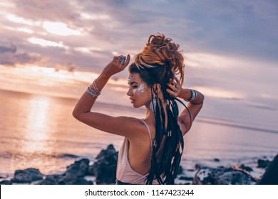 cheerful smiling young woman in elegant dress on the beach at sunset close up portrait