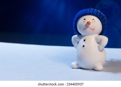 Cheerful snowman on a blue snowy background.