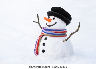 Cheerful snowman on a snowy background. Christmas card with a funny character. Traditional winter fun for kids