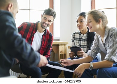 Cheerful staff members of working group discussing successful architectural project in friendly atmosphere, young students satisfied with completing discussion of creative ideas of coursework plan