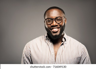Cheerful  student portrait .young  African American man in studio in glasses