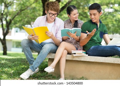 Cheerful students discussing something outside