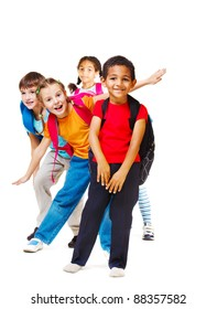 Cheerful students of elementary age, over white