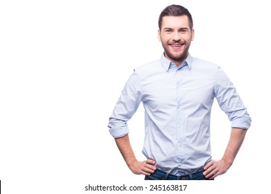 2a2c5164 Handsome young man in shirt looking at camera and holding hands on