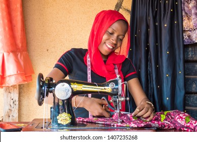 cheerful tailor smiling while working