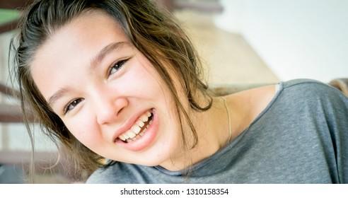 Cheerful cheerful teen girl outdoor portrait close-up