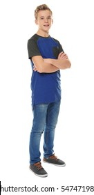 Cheerful teenager in casual clothes on white background