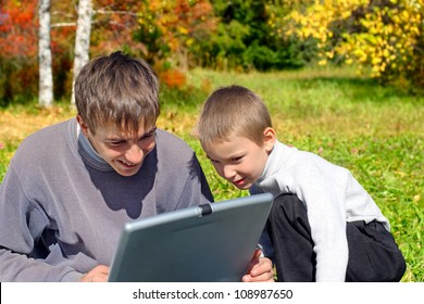 cheerful teenager and kid with notebook outdoor