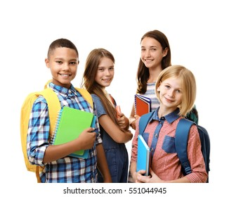 Cheerful teenagers with backpacks and notebooks on white background