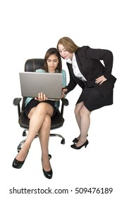Cheerful two Egyptian business women working at the office chair on a laptop,  isolated on white background