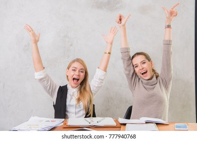 Cheerful Two women General Service Officer when deal office materials discount while they feeling happy and push hand up