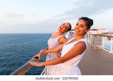 cheerful two women having fun on cruise ship