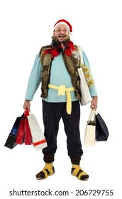 Cheerful vagrant is feeling so happy with Christmas shopping bags