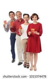 Cheerful vietnamese senior doctor holding medical stock photo cheerful vietnamese people holding tet greeting cards and looking at camera m4hsunfo Choice Image