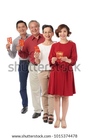 Cheerful vietnamese people holding tet greeting stock photo edit cheerful vietnamese people holding tet greeting cards and looking at camera m4hsunfo