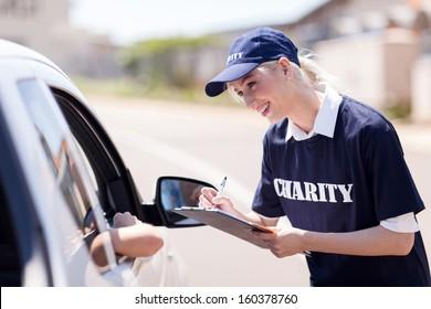 cheerful volunteer raising money for charity on street