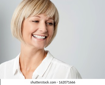 Cheerful woman against grey background