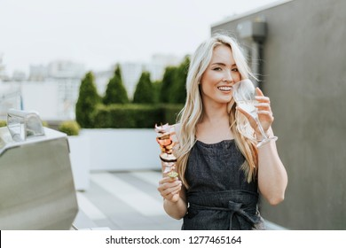 Cheerful woman with a barbeque skewer