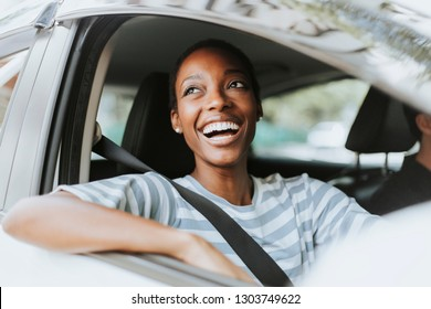 Cheerful woman in a car