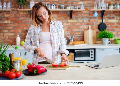 Cheerful woman cooking on modern kitchen