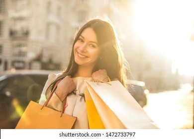 Cheerful woman doing shopping in a big city