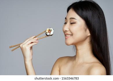Cheerful woman eating chopsticks snack food ration fun