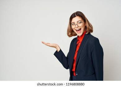 cheerful woman in glasses and jacket