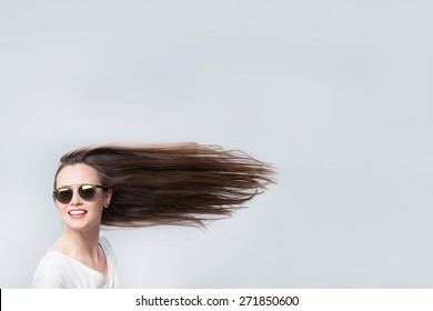 Cheerful woman with hair in the wind