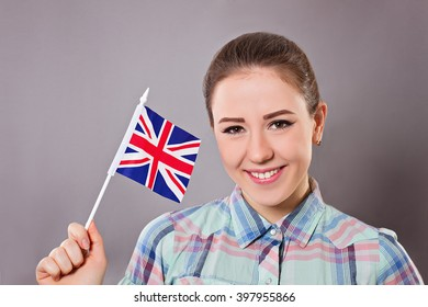 Cheerful woman holding british flag