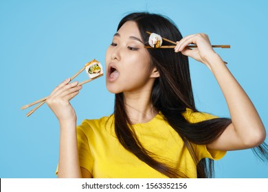 Cheerful woman of Korean appearance snacking chopsticks