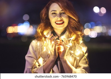 Cheerful woman with light bulb
